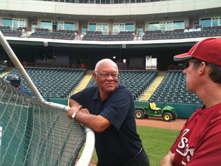 Enos Cabell speaks with Ty Van Burkleo, roving hitting instructor for the Astros, before Tuesday's RedHawks game at Chickasaw Bricktown Ballpark. Photo provided.