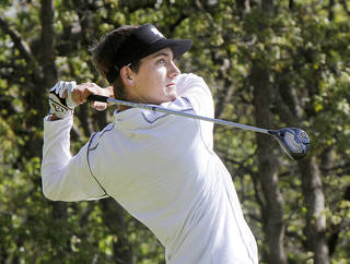 Edmond Santa Fe's Drew Ison tees off during the 2013 Class 6A state golf tournament at Karsten Creek in Stillwater. Ison has won two straight tournaments. Photo By Paul Hellstern, The Oklahoman Archives