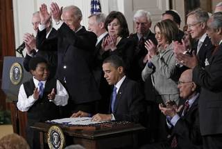 In this March 23, 2010 file photo, President Barack Obama is applauded after signing the health care bill in the East Room of the White House in Washington. Obama's terrible, horrible, no good, very bad year got off to a terrible, horrible, no good, very bad start. (AP Photo/Charles Dharapak, File)