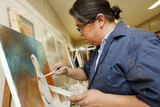 "Artist Marwin Begaye participates in a ""live paint"" at a downtown art gallery in Norman in 2010. Begaye will again take part in a ""live paint"" Thursday at the Big Foot Creative gallery in downtown Norman. OKLAHOMAN ARCHIVES"