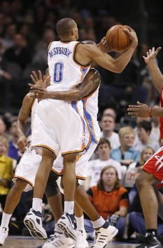 Russell Westbrook colides with Joe Smith on a rebound in the first half as the Oklahoma City Thunder plays the Houston Rockets at the Ford Center in Oklahoma City, Okla. on Friday, January 9, 2009. Photo by Steve Sisney/The Oklahoman