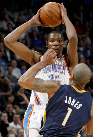 Oklahoma City's Kevin Durant (35) looks to shoot over Indiana's Dahntay Jones (1) during the NBA basketball game between the Oklahoma City Thunder and the Indiana Pacers at the Oklahoma City Arena, Wednesday, March 2, 2011. Photo by Bryan Terry, The Oklahoman