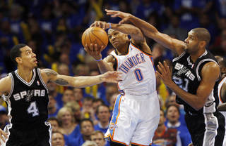 Oklahoma City's Russell Westbrook (0) grabs a rebound between San Antonio's Danny Green (4) and Tim Duncan (21) during Game 3 of the Western Conference Finals between the Oklahoma City Thunder and the San Antonio Spurs in the NBA playoffs at the Chesapeake Energy Arena in Oklahoma City, Thursday, May 31, 2012. Oklahoma City won, 102-82. Photo by Nate Billings, The Oklahoman