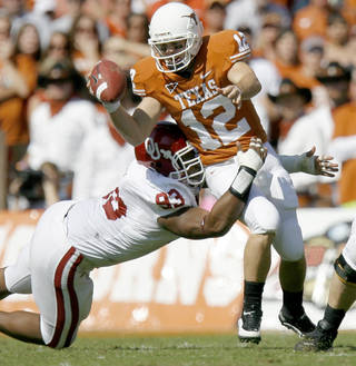 Gerald McCoy brings down Colt McCoy in OU's 16-13 to Texas. Photo by Bryan Terry, The Oklahoman.