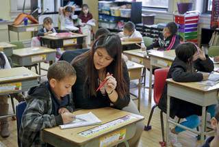 Second-grade teacher Jennifer Lopez works with a student in her classroom at Putnam Heights Elementary School. Lopez is one of three teachers at the school who were trained through the Urban Teacher Preparation Academy. PHOTO BY CHRIS LANDSBERGER, THE OKLAHOMAN CHRIS LANDSBERGER - CHRIS LANDSBERGER