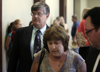 Kenneth A. Adams, left, a former physician assistant at Claremore Veterans Center, leaves a Rogers County District Court courtroom Monday in Claremore. He is facing two counts of second-degree murder and two counts of caretaker neglect in the deaths of two patients at the veterans center. Photo: Mike Simons, Tulsa World