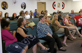 A crowd listens Tuesday, May 14, 2013, as a motion to not renew the business license for Joe's Addiction coffee shop by the town's Board of Trustees is discussed during a meeting in Valley Brook. Residents of the town are concerned about number of sex offenders they say are frequenting the business. Photo by Bryan Terry, The Oklahoman Bryan Terry - THE OKLAHOMAN