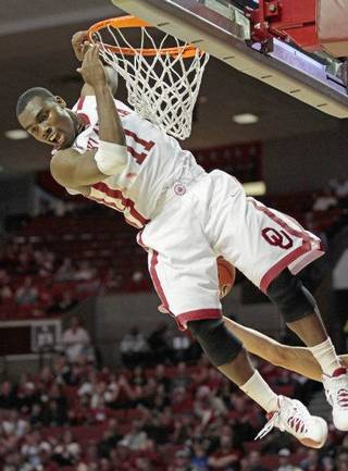 Oklahoma's Calvin Newell dunks against Idaho State. Newell scored 19 points in the win. Photo by Steve Sisney, The Oklahoman