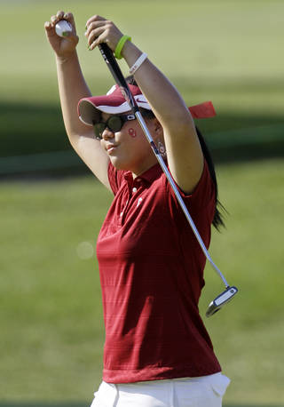 Oklahoma's Chirapat Jao-Javanil celebrates after finishing her final round at the NCAA Division I women's golf championship Friday, May 25, 2012, in Franklin, Tenn. Jao-Javanil won the individual championship at 6-under-par 282. (AP Photo/Mark Humphrey) ORG XMIT: TNMH103