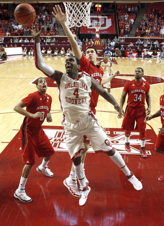 Oklahoma's Andrew Fitzgerald (4) goes to the basket between Nebraska's Toney McCray (0) Jorge Brian Diaz (21) and Lance Jeter (34) during the NCAA college basketball game between the University of Oklahoma Sooners and Nebraska Cornhuskers at Lloyd Noble Center in Norman, Okla., Wednesday, Feb. 16, 2011. Photo by Bryan Terry, The Oklahoman