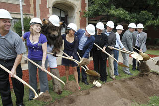 Dignitaries including Rumble and Mayer Mick Cornett break ground during a school assembly celebrating the MAPS for Kids renovation of Emerson High School in Oklahoma City. PHOTOS BY PAUL HELLSTERN, THE OKLAHOMAN