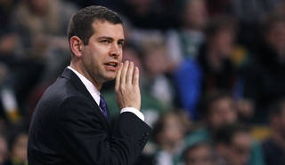 Boston Celtics head coach Brad Stevens calls to his players during the first quarter of an NBA basketball game against the New Orleans Pelicans, Friday, Jan. 3, 2014, in Boston. (AP Photo/Charles Krupa)