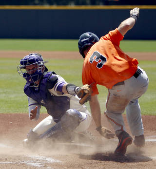 TCU catcher Kyle Bacak is late on the tag as Oklahoma State's Saulyer Saxon scores during an NCAA college baseball game, Sunday, April 14, 2013, in Fort Worth, Texas. (AP Photo/The Fort Worth Star-Telegram, Richard W. Rodriguez) MAGS OUT; (FORT WORTH WEEKLY, 360 WEST); INTERNET OUT ORG XMIT: TXFOR101