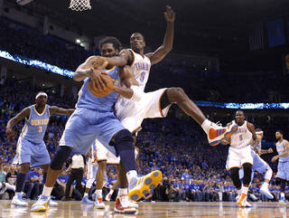 Oklahoma City's Serge Ibaka (9) fights for the ball with Denver's Nene (31)during the first round NBA playoff game between the Oklahoma City Thunder and the Denver Nuggets on Sunday, April 17, 2011, in Oklahoma City, Okla. Photo by Chris Landsberger, The Oklahoman
