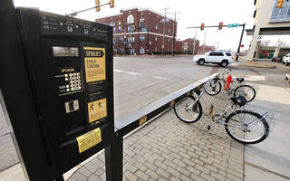 Officials say since the installation of Spokies cycle stations, like the one pictured at NE 2 and Walnut Avenue in Oklahoma City, the program has seen a steady increase in riders. Photo by Paul B. Southerland, The Oklahoman PAUL B. SOUTHERLAND -