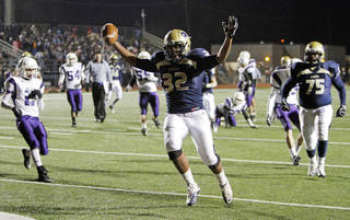Heritage Hall's Quintaz Struble (32) celebrates after catching a touchdown pass in the first quarter during the Class 3A high school football semifinal playoff game between Heritage Hall and Bethany at Putnam City High School in Oklahoma City, Saturday, December 4, 2010. Photo by Nate Billings, The Oklahoman