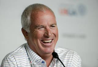 Curtis Strange talks to the media during a news conference for the U.S. Open golf tournament in Pinehurst, N.C., Monday, June 9, 2014. (AP Photo/Chris Carlson)