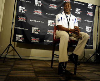 Kansas linebacker Steven Johnson smiles between questions during NCAA college football Big 12 Media Days, Tuesday, July 26, 2011, in Dallas. (AP Photo/Matt Strasen)