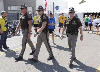 Oklahoma Highway Patrol troopers provide part of the security for the Oklahoma City Memorial Marathon in Oklahoma City, Sunday, April 28, 2013, By Paul Hellstern, The Oklahoman
