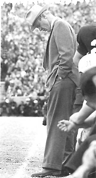 Bud Wilkinson, OU football coach, hangs his head on the sideline during the Sooners 7-0 loss to Notre Dame on Nov. 16, 1957. The loss ended OU's 47-game win streak. FROM THE OKLAHOMAN ARCHIVES