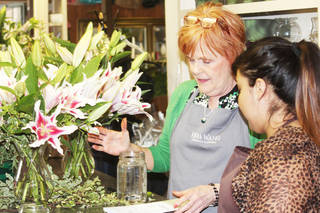 Barbara Bilke, owner of Madeline's Floral Shop, works with horticulture student Jacqueline Sanchez. PHOTO PROVIDED