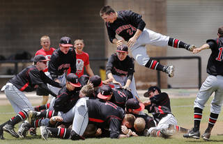 Because he plays in the outfield, senior Tanner Smith was one of the last Verdigris players to leap onto the dog pile in front of the team's dugout after defeating Vian to win the Class 3A high school state championship baseball game at Edmond Santa Fe High School Saturday afternoon, May 11, 2013. Photo by Jim Beckel, The Oklahoman.