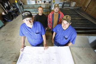 Doug Tolliver (left), owner of Masters Heating & Air in Del City, is paying the base monthly retainer of a startup medical care company for any worker who wants it. Tolliver and, from left, employees Jeremie Sims, Tommy Henderson and Mike Sims pose in the business' sheet metal shop. Photo By Steve Gooch, The Oklahoman Steve Gooch