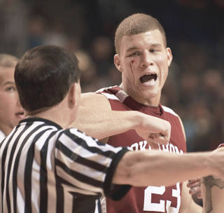 OU's Blake Griffin was bloodied by an elbowed to the face on Monday night against Rice in Houston. AP photo