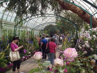 """In this May 26, 2012 photo, visitors to the New York Botanical Garden in New York walk through """"Monet's Garden,"""" which evokes the impressionist artist Claude Monet's garden at Giverny, his home in France, from 1883 until his death in 1926. The exhibit runs through Oct. 21. (AP Photo/Ray Stubblebine) Ray Stubblebine - AP"""