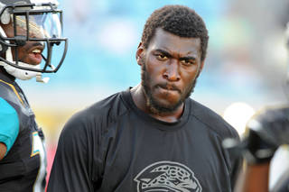 Jacksonville Jaguars wide receiver Justin Blackmon speaks with a team mate during warmups before an NFL preseason football game against the Miami Dolphins, Friday, Aug. 9, 2013, in Jacksonville, Fla. Blackmon sat out the game because of groin surgery. (AP Photo/Stephen Morton)