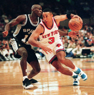 New York Knicks guard John Starks (3) takes the ball around San Antonio Spurs guard Vernon Maxwell in the first quarter of their pre-season game in New York's Madison Square Garden Thursday, Oct. 17, 1996. (AP Photo/Kevin Larkin)