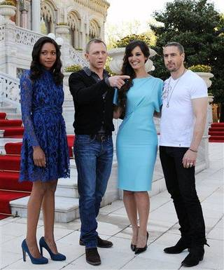 French actress Berenice Marlohe, second right, British actor Daniel Craig and British actress Naomie Harris and actor Ola Rapace, right, arrive for the photocall of the 23rd film in the James Bond series, 'Skyfall', in Istanbul, Turkey, Sunday, April 29, 2012.(AP Photo )