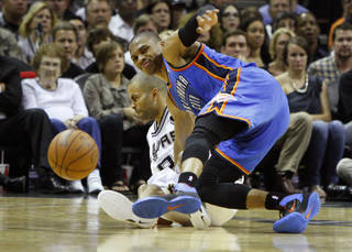 Oklahoma City's Russell Westbrook (0) falls down after hitting San Antonio's Tony Parker (9) during Game 2 of the Western Conference Finals between the Oklahoma City Thunder and the San Antonio Spurs in the NBA playoffs at the AT&T Center in San Antonio, Texas, Tuesday, May 29, 2012. Oklahoma City lost 120-111. Photo by Bryan Terry, The Oklahoman