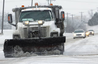 A snow plow moves south on Flood near Tecumseh Rd. after Thursday's winter storm on Friday, Jan. 29, 2010, in Norman, Okla. Photo by Steve Sisney, The Oklahoman