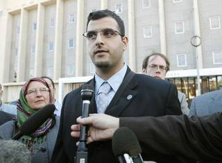 Muneer Awad talks Monday with reporters outside the Oklahoma City federal courthouse after a judge extended a temporary restraining order over State Question 755. PAUL HELLSTERN