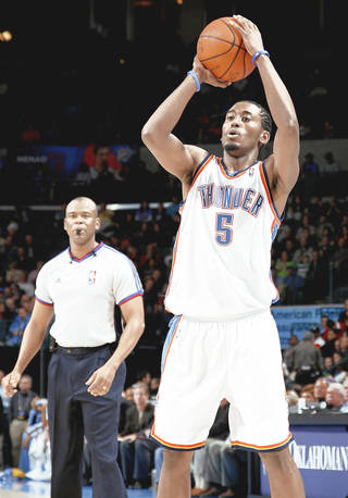 Oklahoma City's Kyle Weaver passes the ball during the NBA basketball game between the Oklahoma City Thunder and the Denver Nuggets at the Ford Center on Wednesday. Photo By BRYAN TERRY, THE OKLAHOMAN