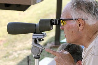 """Mugs"" Tyler, from Arizona, uses a scope to watch shots during the International Handgun Metallic Silhouette World Championships at the OKC Gun Club near Arcadia, OK, Friday, July 13, 2012. More than 600 shooters from four different countries are competing. By Paul Hellstern, The Oklahoman PAUL HELLSTERN - Oklahoman"