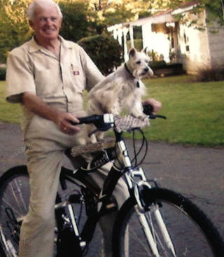 JIm Mitchell and MItzi ride a bicycle together. Photo provided