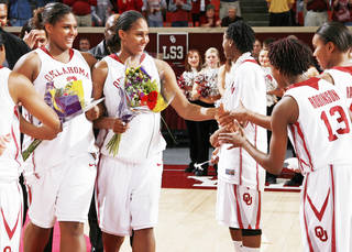 Courtney Paris, left, and Ashley Paris greet Danielle Robinson and Jasmine Hartman during 2009 senior night festivities. While the Paris sisters have moved on, they left a big impact with the players they helped recruit to the program and the example they set for their teammates. PHOTO BY NATE BILLINGS, THE OKLAHOMAN ARCHIVE