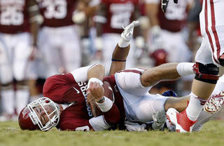 Oklahoma's Trevor Knight (9) is brought down during a college football game between the University of Oklahoma Sooners (OU) and the West Virginia University Mountaineers at Gaylord Family-Oklahoma Memorial Stadium in Norman, Okla., on Saturday, Sept. 7, 2013. Oklahoma won 16-7. Photo by Bryan Terry, The Oklahoman