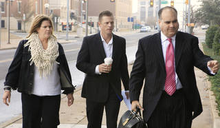 Dryden Mitchell, center, arrives Monday with his attorneys, Michelle Greene and Billy Bock, for his sentencing at the Oklahoma City federal courthouse. Photo by Paul B. Southerland, The Oklahoman PAUL B. SOUTHERLAND