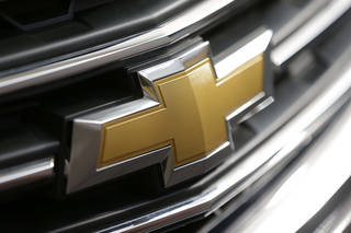 A Chevrolet logo on the grill of a 2013 Traverse is shown at the 2013 Pittsburgh Auto Show in Pittsburgh. AP Photo Gene J. Puskar - AP