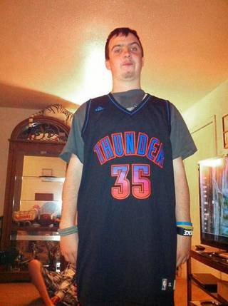 SHOOTING VICTIM: Bronson Quickle, 17, on his 17th birthday in a Thunder jersey he received as a gift. Quickle was shot early Tuesday May 8, 2012 in an apparent robbery attempt. Provided
