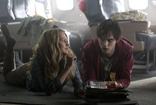 "Teresa Palmer and Nicholas Hoult in a scene from ""Warm Bodies."" Summit Entertainment Photo Jan Thijs"