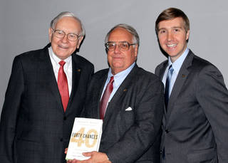 """Howard G. Buffett, center, author of """"40 Chances: Finding Hope in a Hungry World,"""" his father, Warren Buffett, and his son, Howard W. Buffett, gather for a group portrait at Bloomberg headquarters in New York. Photo by Lili Rosboch, Bloomberg News LILI ROSBOCH - BLOOMBERG NEWS"""