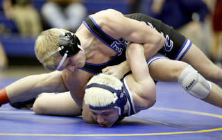 Shawnee's Corey Todd, bottom, and Harrah's Austin Goyette in the 135-pound match during the West Regional Wrestling Tournament, Friday, Feb. 18, 2010, at Harrah High School. Photo by Sarah Phipps, The Oklahoman