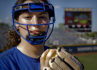 Kentucky pitcher Kelsey Nunley poses for a photo while wearing her face mask during the Women's College World Series media day at ASA Hall of Fame Stadium on Wednesday, May 28, 2014 in Oklahoma City, Okla. Photo by Chris Landsberger, The Oklahoman