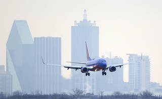 A Southwest Airlines jet comes in for a landing at Love Field in Dallas. AP File Photo LM Otero -
