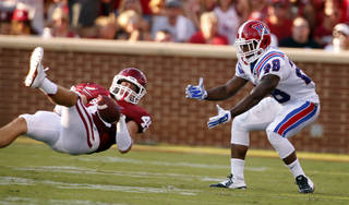 Oklahoma Sooner Caleb Gastelum (45) deflects a pass intended for Kenneth Dixon during a college football game between the University of Oklahoma Sooners (OU) and the Louisiana Tech Bulldogs at Gaylord Family-Oklahoma Memorial Stadium in Norman, Okla., on Saturday, Aug. 30, 2014. Photo by Steve Sisney, The Oklahoman