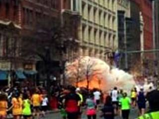 In this image from video provided by WBZ TV, spectators and runners run from what was described as twin explosions that shook the finish line of the Boston Marathon, Monday, April 15, 2013, in Boston. Two explosions shattered the euphoria of the Boston Marathon finish line on Monday, sending authorities out on the course to carry off the injured while the stragglers were rerouted away from the smoking site of the blasts. (AP Photo/WBZTV) MANDATORY CREDIT ORG XMIT: NYKS101